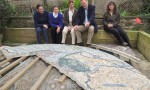 The project team view the half-complete mosaic at the artist's studio