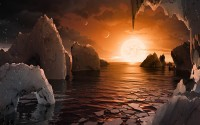 This artist's concept allows us to imagine what it would be like to stand on the surface of the exoplanet TRAPPIST-1f, located in the TRAPPIST-1 system in the constellation Aquarius.   Because this planet is thought to be tidally locked to its star, meaning the same face of the planet is always pointed at the star, there would be a region called the terminator that perpetually divides day and night. If the night side is icy, the day side might give way to liquid water in the area where sufficient starlight hits the surface.   One of the unusual features of TRAPPIST-1 planets is how close they are to each other -- so close that other planets could be visible in the sky from the surface of each one. In this view, the planets in the sky correspond to TRAPPIST1e (top left crescent), d (middle crescent) and c (bright dot to the lower right of the crescents). TRAPPIST-1e would appear about the same size as the moon and TRAPPIST1-c is on the far side of the star. The star itself, an ultra-cool dwarf, would appear about three times larger than our own sun does in Earth's skies.  The TRAPPIST-1 system has been revealed through observations from NASA's Spitzer Space Telescope and the ground-based TRAPPIST (TRAnsiting Planets and PlanetesImals Small Telescope) telescope, as well as other ground-based observatories. The system was named for the TRAPPIST telescope.  NASA's Jet Propulsion Laboratory, Pasadena, California, manages the Spitzer Space Telescope mission for NASA's Science Mission Directorate, Washington. Science operations are conducted at the Spitzer Science Center at Caltech in Pasadena. Spacecraft operations are based at Lockheed Martin Space Systems Company, Littleton, Colorado. Data are archived at the Infrared Science Archive housed at Caltech/IPAC. Caltech manages JPL for NASA.
