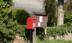Communications in the countryside: a small post box and a village notice board